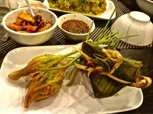 Chicken-stuffed lemongrass and fish steamed in banana leaves
